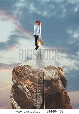Young Businessman Take Off With A Rocket Over Mountain Cliff With A Ladder. Launch Start Up Business