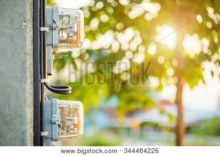 Electric Meter Installed On The Pole To Measurement Watt In The House