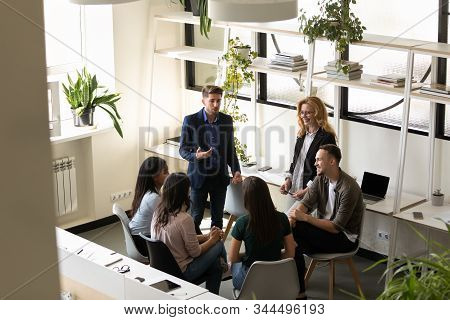 Six Diverse Businesspeople Chatting During Break In Co-working Space