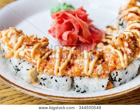 Japanese Rolls With Tobiko Caviar On A Plate With Pickled Ginger And Wasabi. Rice With Sesame Seeds,