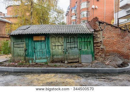 City Street Yard With Old Decrepit Wooden Barn