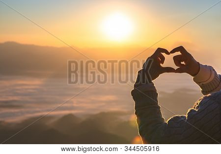 Woman Making Heart Shape During Sun Rise, God Is Love Concept, Heart Shape, Mountain Tourism,  The M
