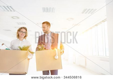 Business people relocating to new office with yellow lens flare in background
