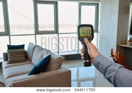 thermal imaging camera at apartment inspection for finding heating leakage