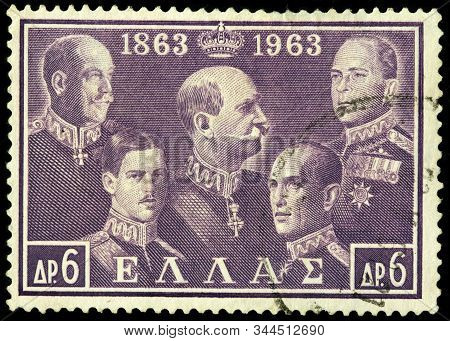 Luga, Russia - October 25, 2019: A Stamp Printed By Greece Shows Portraits Of Of Greek Kings George