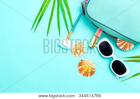 Travel Feminine Accessories And Cosmetics  On Blue Background. Copy Space. Color 2020