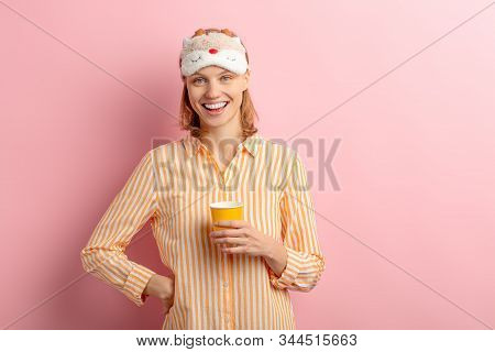 Portrait Of Beautiful Smiling Woman Drinking Cup Of Coffee Or Tea After Sleeping, Look At Camera And