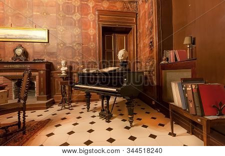 Palermo, Italy: Piano And Antique Books Inside Historic Palazzo Alliata Di Villafranca, A Baroque Ar