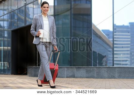 Portrait Of Successful Business Woman Traveling With Case At Airport. Beautiful Stylish Female Trave