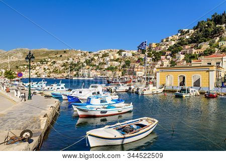 Symi Island, Dodecanese Islands, Greece - May 18, 2016: Scenic Waterfront On The Greek Island Of Sym