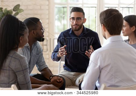 Multiethnic Young People Talk At Psychological Group Training