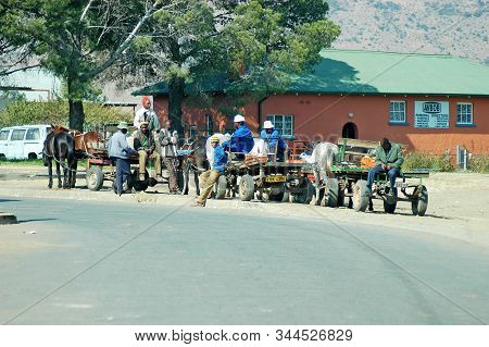 Thaba Nchu. South Africa, May 18, 2004: Horse Drawn Carriages And People In Front Of A Funeral Parlo