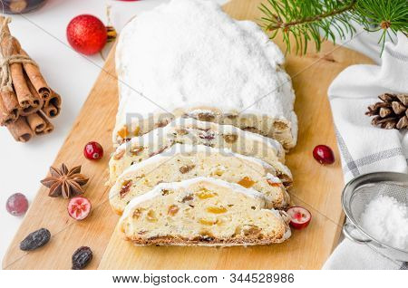 Christmas Stollen With Mix Dried Fruits, Nuts And Icing Sugar On The Board. Traditional German Chris