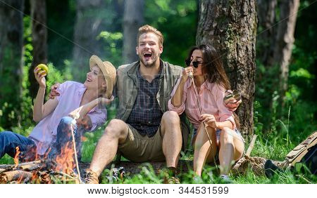 Company Friends Relaxing And Having Snack Picnic Nature Background. Halt For Snack During Hiking. Co