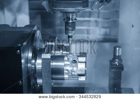 The  Multi-axis  Cnc Milling Machine  Tapping The Thread At The Aluminium Casting Parts By Tapping T