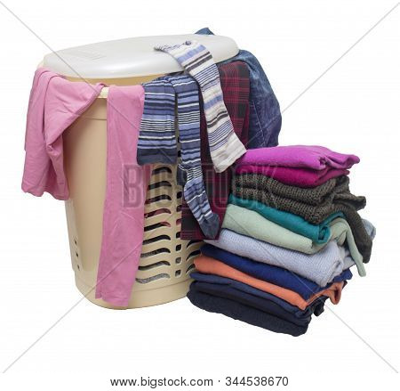 Plastic Filled Laundry Basket, From Under The Cover Of Which You Can See Different Messy Clothes And
