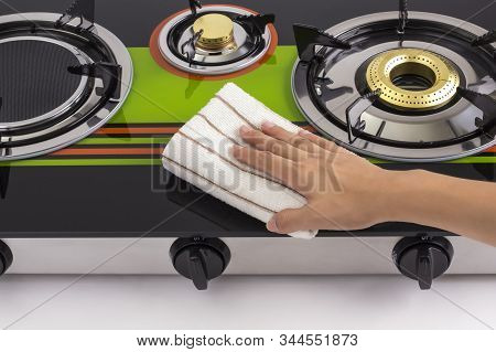 Image Of Housewife Hand Cleaning Gas Stove