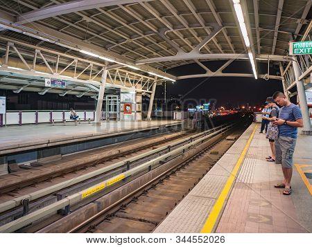 Bangkok/thailand-15 Feb 2019:unacquainted People On Wongwianyai Bts Skytrain In Bangkok City Thailan