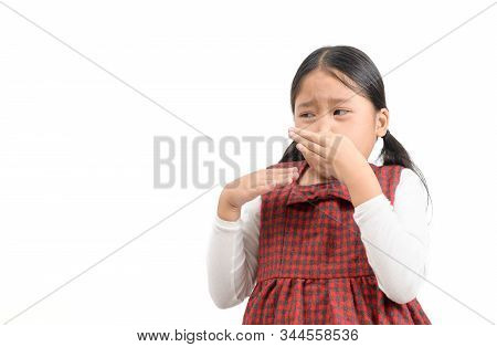 Smells Bad, Awful Odor. Cute Asian Girl  Squeezing Nose With Fingers With Disgust Expression, Eager