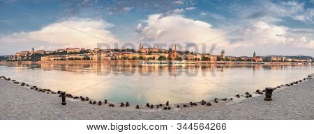 Big panorama of Buda side of Budapest with the Buda Castle, St. Matthias and Fishermen's Bastion. Shoes on the Danube memorial to Jewish victims during WWII on the Danube River in Budapest, Hungary.