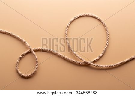 Rope Loop On A Cream Color Background. Rope With Loops Close-up.