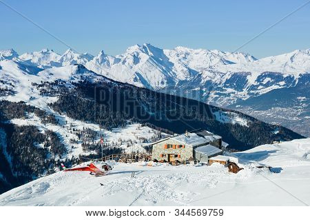 St Luc, Switzerland - December 30, 2019: Swiss Mountain Rescue Helicopter Just Landed At Bella Tola