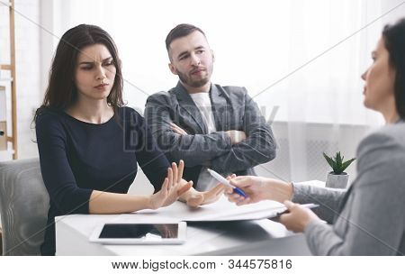 Deceived Couple Disputing About Mortgage Loan Or Real Estate Problem With Realtor, Rejecting Signing