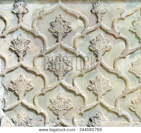 Decorative marble bas-relief with floral ornament in Golestan Palace (Marble Palace, Palace of Roses), royal Qajar complex in Tehran, Iran. UNESCO world heritage site