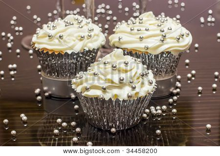 Closeup of White Cupcakes with Silver Sprinkles