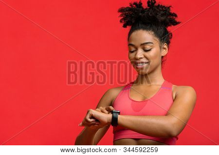 Fitness Afro Girl Using Activity Tracker Smartwatch As Heart Rate Monitor For Workout Or Tracking He