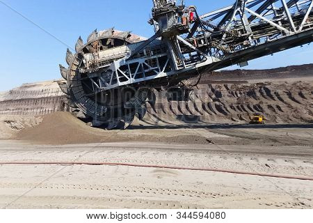The Work Of A Bucket Wheel Excavator In A Quarry. Ore Mining In A Quarry.