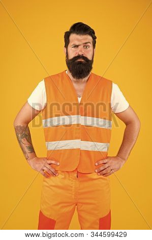 Brutal And Professional. Brutal Caucasian Man With Long Beard On Yellow Background. Brutal Hipster W