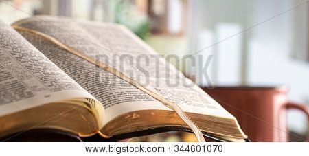 Book Bible Close-up, On A Beautiful Terrace Background. Morning Time. Space For Text.