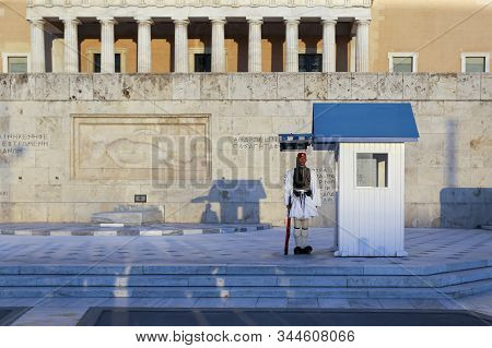 Greek Parliament At Syntagma Square In Athens, Greece 2017-10-01 A Guard At Sunset In Front Of The G