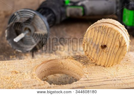 Wood Hole Saw And Raw Board. Making Holes In Raw Wood.