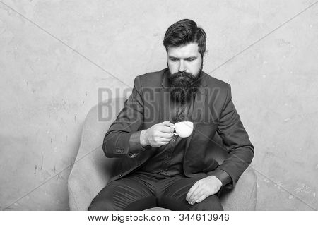 Break Time. Businessman Relaxing During Work Break At Workplace. Bearded Man Drinking Coffee During