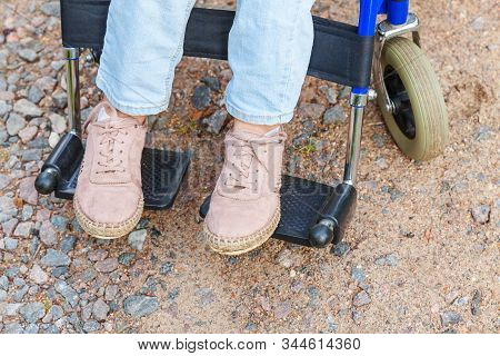 Legs Feet Handicap Woman In Wheelchair Wheel On Road In Hospital Park Waiting For Patient Services.