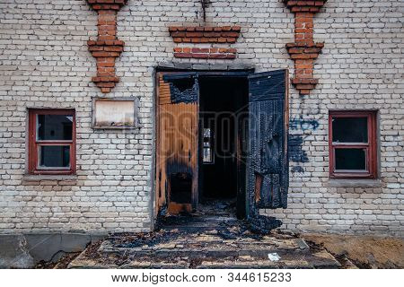 Consequences Of Fire. Burnt Brick House. Burned Entrance Door