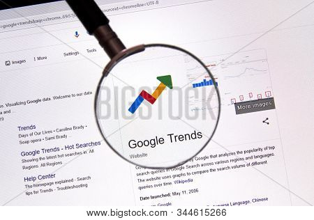 Montreal, Canada - July 14, 2019: Google Trends Web Site Under Magnifying Glass. Google Llc Is An Am