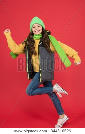 Get Outside Whatever The Weather. Energetic Child In Motion Red Background. Little Girl With Energet