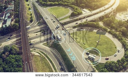 Autonomous Self Driving Cars Concept. Aerial View Of Cars And Buses Moving On City Intersection And