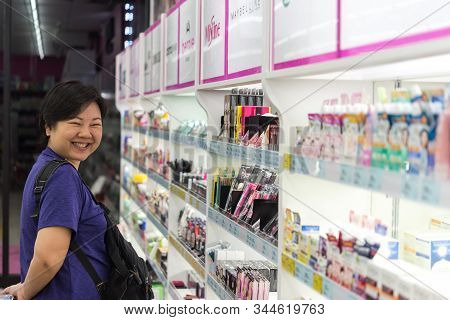 Bangkok, Thailand - November 16, 2019 : Asian Woman With Many Types Of Cosmetics For Beauty And Skin