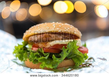Hamburger Is A Fast Food Make From Bun, Meat, Cheese And Vegetable  In Fastfood Restaurant, Unhealth
