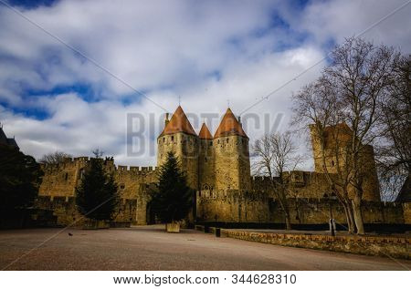 Carcassonne is one of the most beautiful fortified cities in France with double walls, towers, bridge and gateway to the city, castle, and Gothic-style basilica