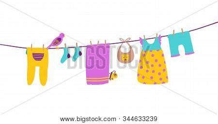 Baby Clothes On Clothesline Hanging And Drying. Clean And Bright Apparel. Cartoon Vector Illustratio
