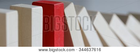 Focus On Red Object Refusing To Bend Under Harsh Circumstances Affecting Other In Irreversible Seque