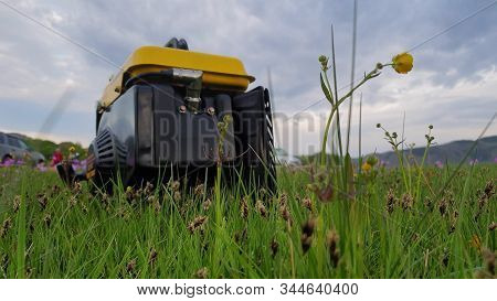 Close Up Of Gas Diesel Mobile Portable Electricity Generator Work On Grass. Gasoline Fuel Powered Po