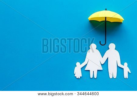 Live Insurance Concept. Family Silhouette Protected By Umbrella On Blue Background Top-down Copy Spa