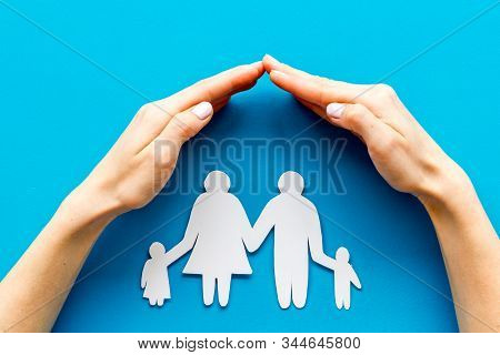 Live Insurance Concept. Family Silhouette Under Palm On Blue Background Top-down