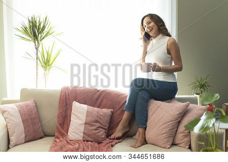 Young Woman Calling Talking On The Phone At Home, Cheerful Teen Girl Enjoys Pleasant Mobile Conversa